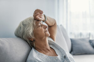 Elderly woman experiencing extreme tiredness.