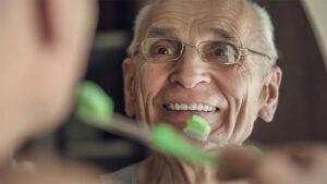 happy-senior-man-dental-hygiene